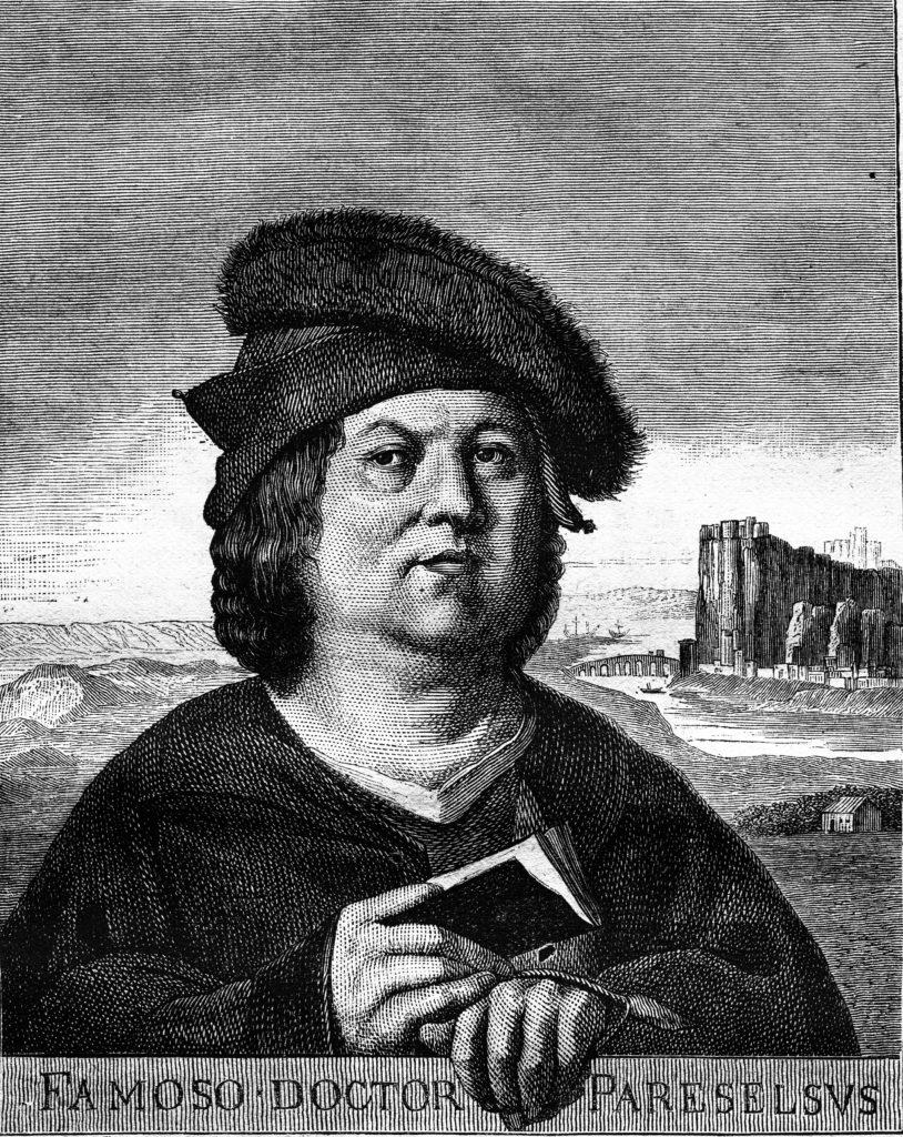 Bild von Paracelsus, der Begründer der modernen Spagyrik, mit Buch in der Hand in schwarz-weiß